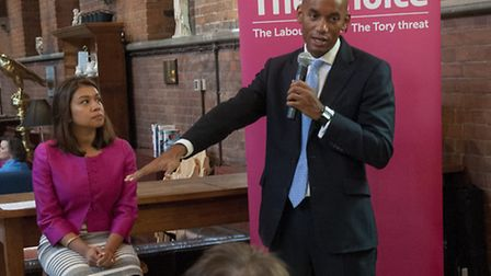 Shadow business secretary Chuka Umunna, with Tulip Siddiq, talking to business owners at the Sherrif
