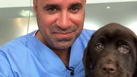 TV vet and PupAid founder Marc Abraham with a responsibly bred puppy