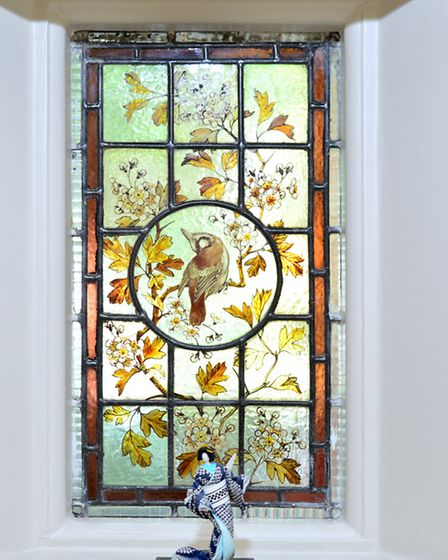 The flat boasts many period features including beautiful stained-glass windows
