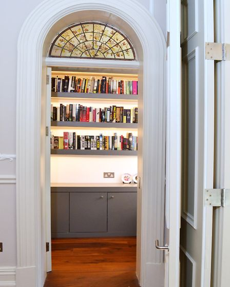 A large cupboard was turned into a study and library to house Paul's book collection