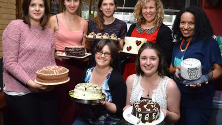 Members of the Camden Clandestine Cake Club meet at Bar 55 in Jamestown Road. From left, back row, K