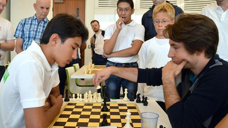 JW3 Mind Sports Olympiad organiser Etan Ilfeld (right) in a chess match with Shanepes Meredov (15) -