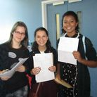 Laura Toulson (L), Lauren Hands (C) and Georgia Ludica-Davies (R), all 16, celebrate getting their G
