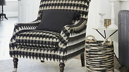 Lucien Chair upholstered in Tessalate Raven, �1,162, Parker Knoll. PA Photo/Handout