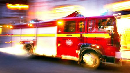A woman has been charged with attempted murder following a fire in Belsize Park