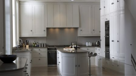 Swiss Cottage kitchen with panel doors set in a beaded frame, finished in Farrow & Ball 'Skimming St