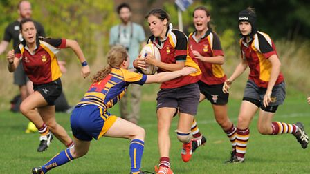 Hampstead's Lilly Hunt (centre), who touched down twice, charges through the Beckenham defence. Pic: