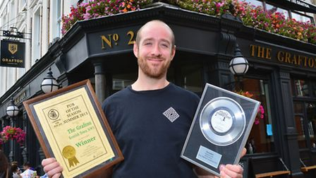 Landlord Joel Czopor from the Grafton Pub in Kentish Town is celebrating being awarded yet another p