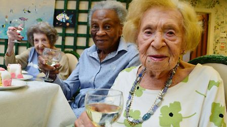 Ruth Kollner (front) celebrating her 100th birthday with fellow care home residents Lena Hayford (mi