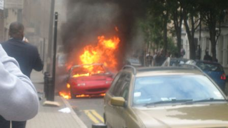 A red sports car set on fire by anarchists in Ellingfort Road. Photo credit Emma Bartholomew