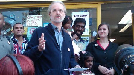 Cllr Ian Rathbone speaking outside Siva's looted shop in August 2011.