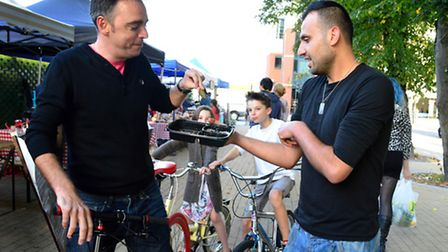 Passer-by David Boudier samples falafel from Racheed Muhammed from Baba Ganash at West Hampstead's n