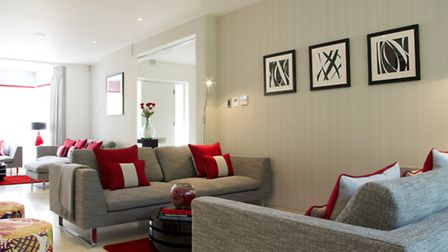 The living room with pops of vibrant red