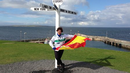 Nieves La Casta flys her native Spanish flag at the finish point in John O'Groats.