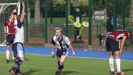 Will Naylor (centre) wheels away after scoring the winning goal, while Oliver Didham (left) celebrat