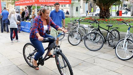 A resident trying out one of the bikes available on the council's bike loan scheme.