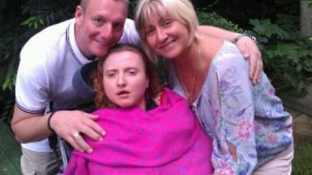Kelly Madarasz with her mother, Edit and stepfather Andrew Furniss.