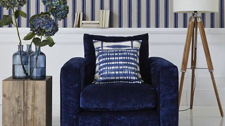Blue mood: Azure chair, £629; Atlas lamp, £175; Portlight mirror, £120; rug, £245, Barker & Stonehou