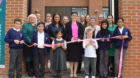 Cllr Sarah Hayward cuts the ribbon with pupils and staff outside the new campus. Picture: Polly Hanc