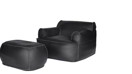 Corral armchair and ottoman in black leather