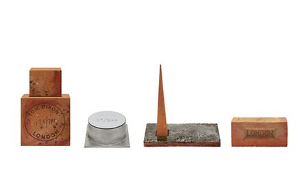 Tom Dixon's MUD range. From l to r: MUD diffuser, candle, obelisk diffuser, and mini diffuser. Each