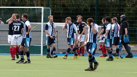 Hampstead's players (in blue and white) are despondent as East Grinstead players celebrate at Padidn
