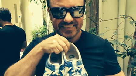 Ricky Gervais shows off his shoes he donated for charity, saying: These shoes have run around New Y