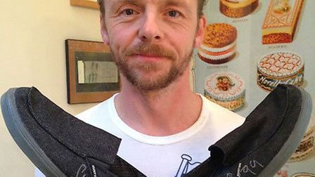 Simon Pegg shows off his shoes he donated for charity