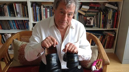 Monty Python's Terry Jones shows off his shoes he donated for charity