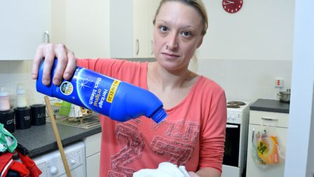 Weedington Road flats resident Natasha Etheridge uses bleach to combat the ants that have invaded th