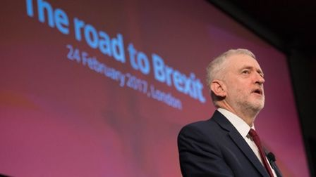 Jeremy Corbyn addresses crowds stood in front of a 'road to Brexit' backdrop