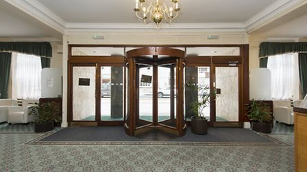 The lobby of the 1930s block in Bloomsbury where Kenneth Williams' 1950s flat is on the market throu