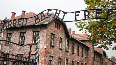 The infamous gate at Auschwitz I greeting visitors with the motto: Work makes you free. Picture: Yak