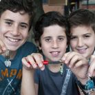 Brothers Josh, 11, (centre) and David Gringras, 13, with friend Joseph Rosenfeld. Picture: Nigel Sut