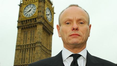 Mike Freer beside Big Ben. Picture: Polly Hancock.
