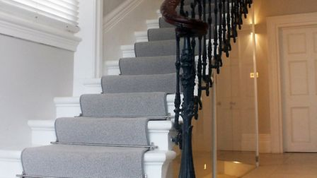 The 1865 cantilevered staircase after it was restored by Primrose Interiors