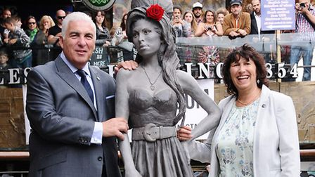 Parents of Amy Winehouse, Mitch and Janice, next to their daughter's statue. Picture: Dieter Perry
