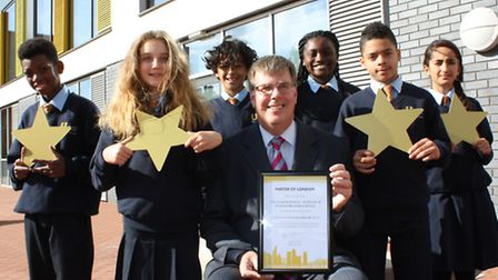 Urswick students and Headteacher Richard Brown celebrate after receiving Gold Club status