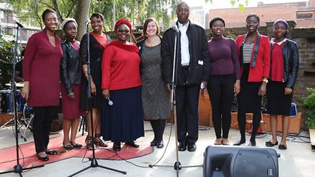 MP Meg Hiller with Cllr kam Adams pictured with members of the Reapers Choir