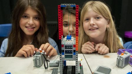 Misty Feldman, Maia Goalen and Alice Lee take part in the Lego engineering classes Picture: Nigel Su