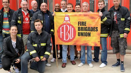 Fire fighters at a march to save Kingsland Fire Station before it closed.