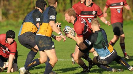 Laurent Stephenson (centre) scored UCS Old Boys' opening try. Pic: Paolo Minoli