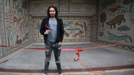 English comedian Russell Brand unveils a mosaic by Hackney Mosaics project in Hackney Downs