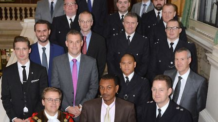 All men: The line-up of commendation winners in October, with borough commander BJ Harrington and Ma