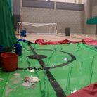 The sports hall is slowly being transformed into a swimming pool