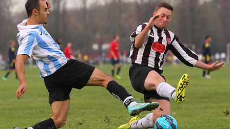 Bow Badgers (black/white) vs FC Grove. Pic: Gavin Ellis/TGSPHOTO