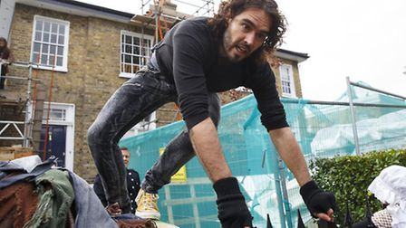 08/11/2014. Russell Brand entering in a The Benyon Estate property to put a banner up on its scaffol
