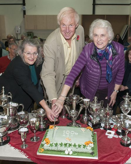 Marjorie Harris, Dr Chris Page and Yvonne Oliver cut the centenary cake. Picture: Nigel Sutton.