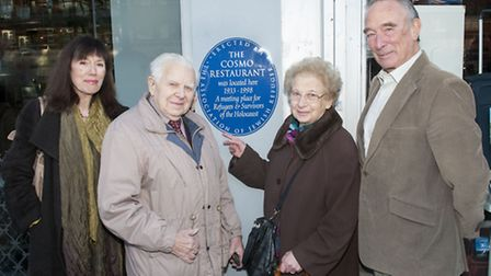 Marion Manheimer, whose parents ran The Cosmo, unveiled the plaque a year ago. Pictured with John an