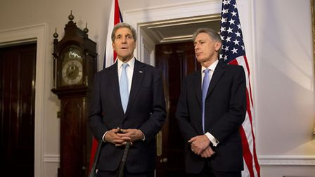 US Secretary of State John Kerry (left) speaks to the media about the attack that took place on wors